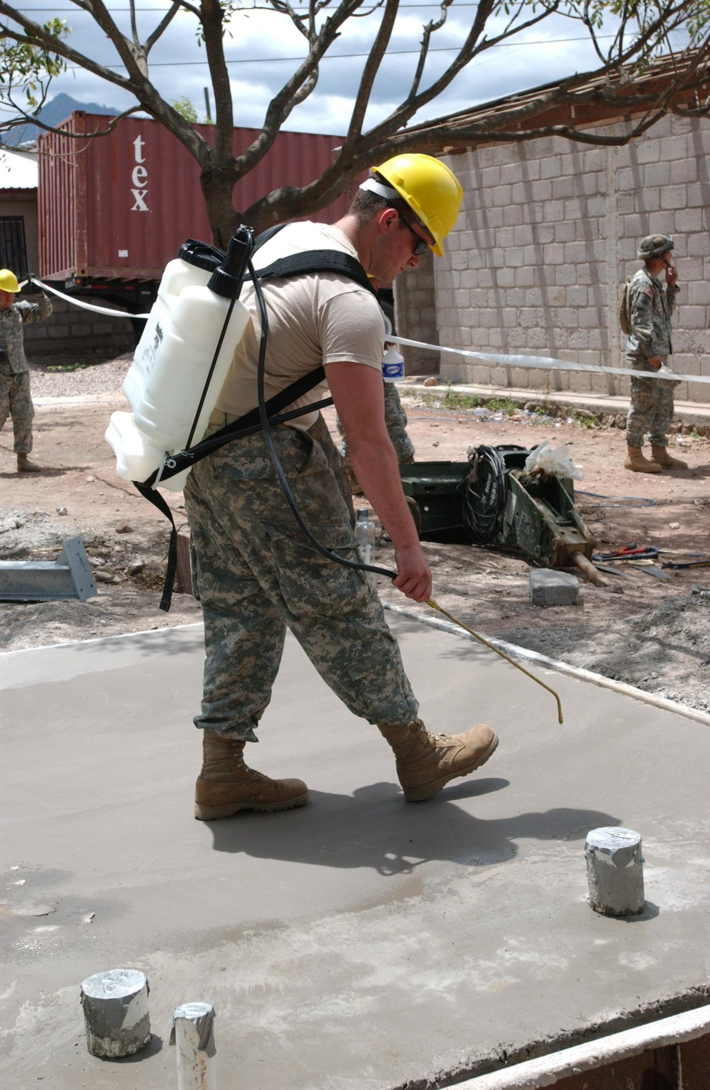 man-preparing-a-concrete-floor-for-concrete-resurfacing-and-epoxy-coating