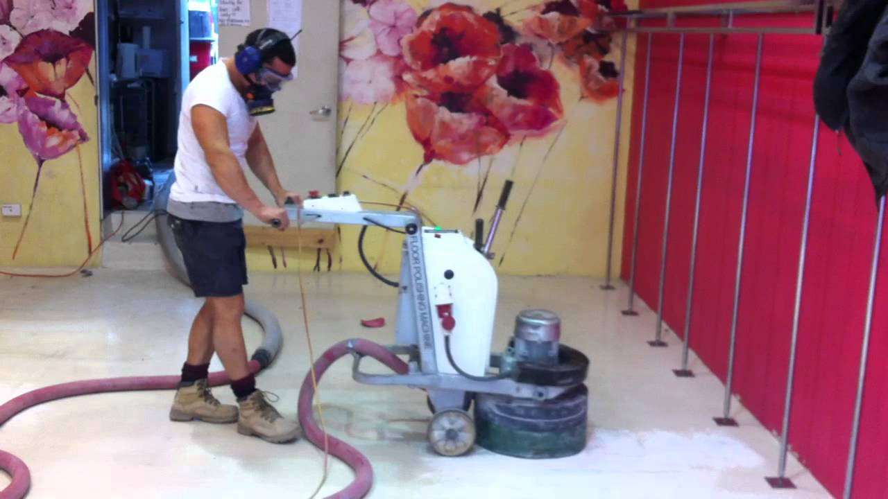 man grinding the epoxy